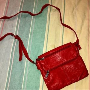 Liz Claiborne coral crossbody purse. Fold over top